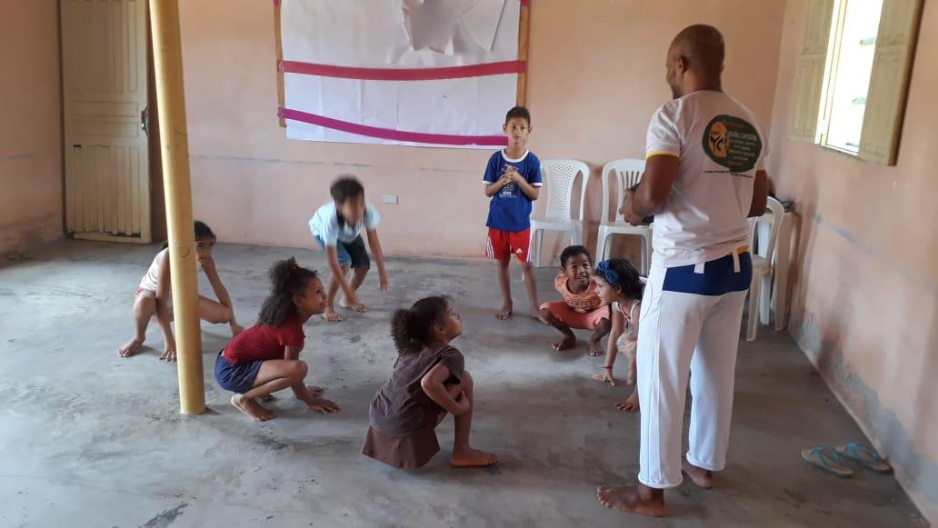 OFICINA DE CAPOEIRA PARA ADOLESCENTES DA COMUNIDADE ...